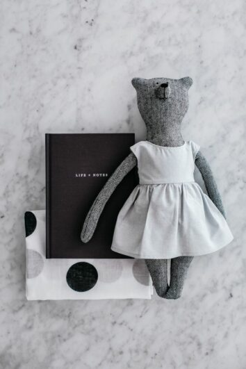 A photo of The Grace Files Bear + Life Kindness Kit showing Grace bear, our Life + Notes journal and organic muslin wrap. A unique baby shower gift.
