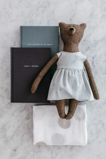 Photo of our Motherhood Kindness Kit featuring Life + Notes journal, Love Letters to My Child, muslin wrap and Grace bear. A beautiful baby gift set.