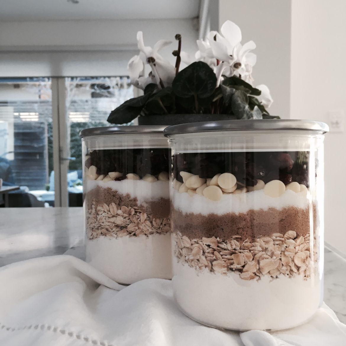 An image showing two jars of hand made cookie dough mix which could make a thoughtful gift for a new mum.